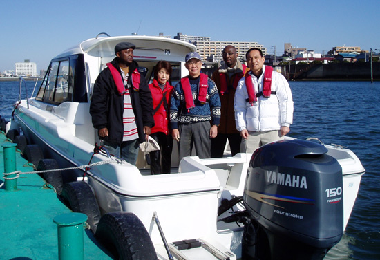 Crew photo: Barry Okori(me), Mr.& Mrs. Arakawa, Felix Missiala, Katsuhiko Egusa(our captain/pilot)
