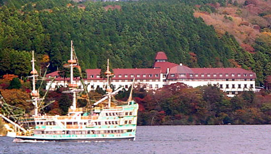 Vasa the Lion of North Europe a replica sea pirate ship or kaizokusen cruises past the Yama Hotel on lake Ashi